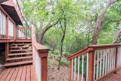 Luxury homes in cedar home on treed lot in eanes