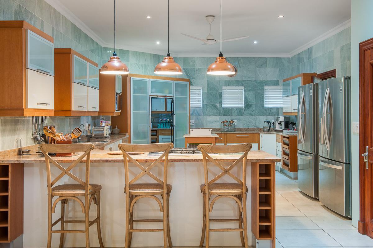 LAVISH BALINESE INSPIRED BEACHFRONT HOME luxury real estate