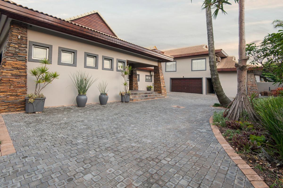 Luxury real estate LAVISH BALINESE INSPIRED BEACHFRONT HOME