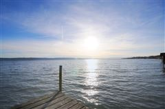 superb lakefront lot with enchanting hunting lodge luxury real estate