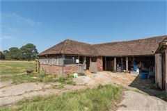 Luxury real estate A wonderful and historic farmhouse with traditional stables and a Kentish barn