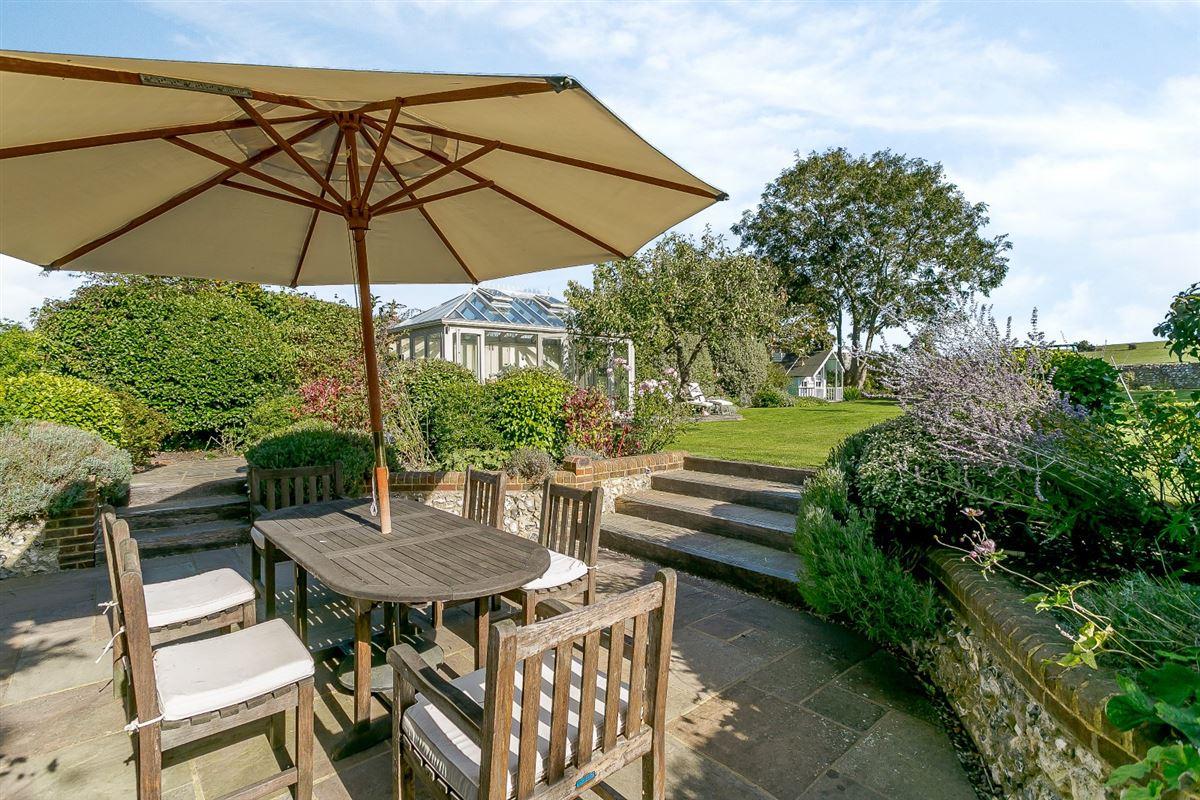 Luxury properties this substantial home boasts wonderful Downland views