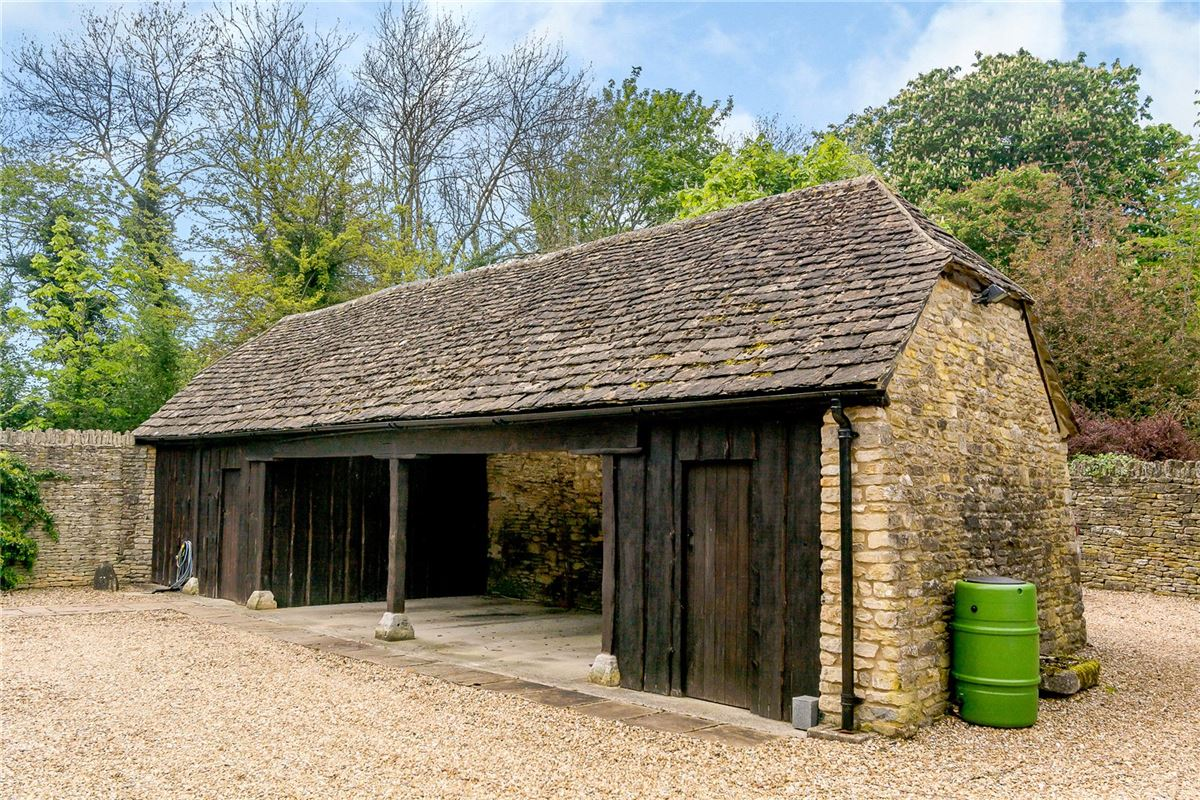 Mansions charming edge of village Cotswold stone barn with land and outbuildings