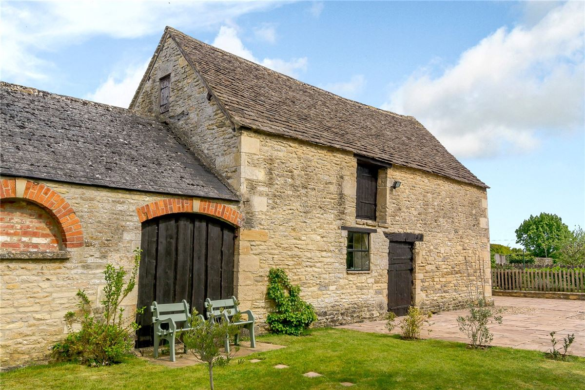 charming edge of village Cotswold stone barn with land and outbuildings mansions