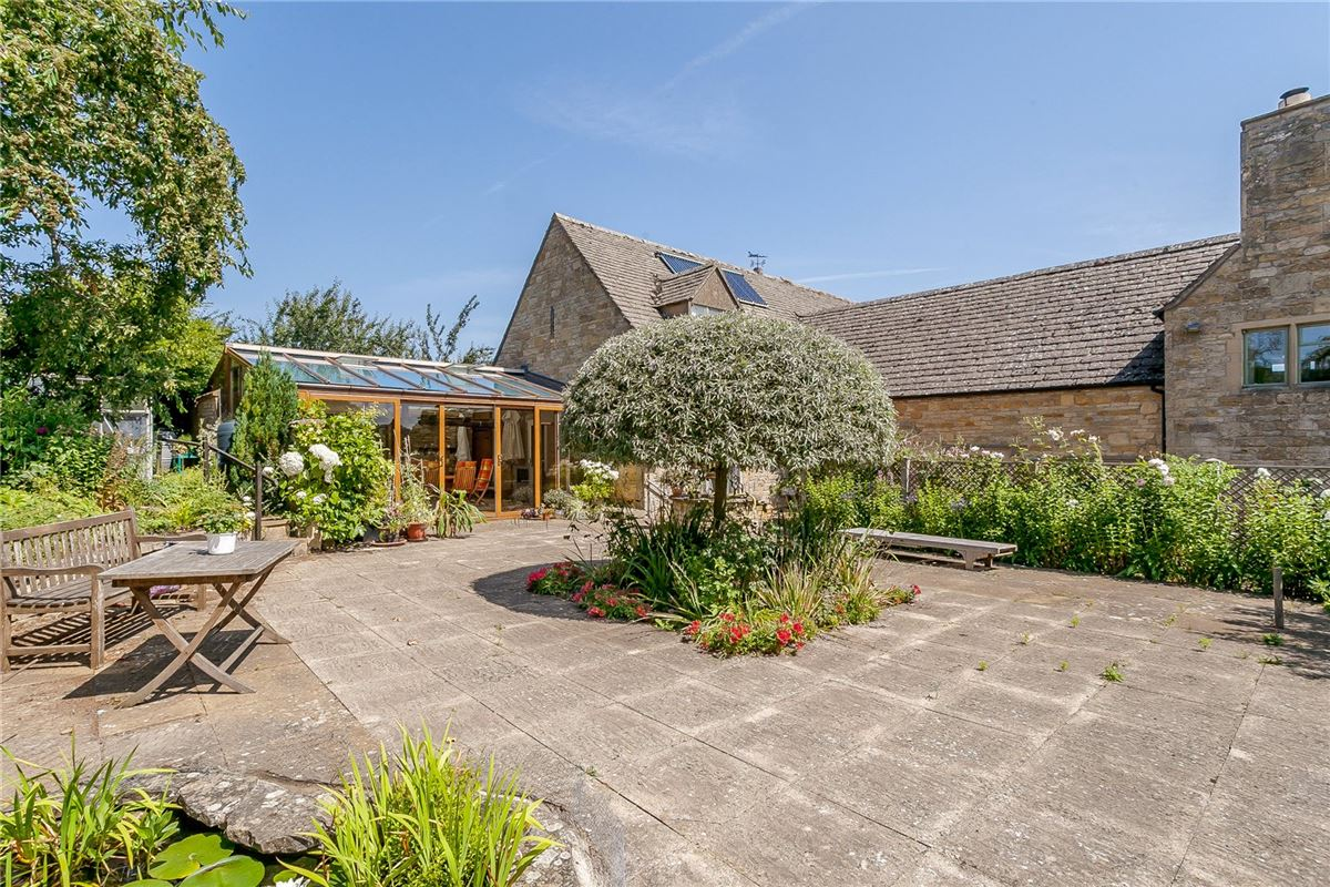 Mansions A spacious barn conversion set on the edge of the village in an elevated position