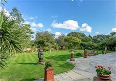 A beautifully maintained country house on lovely grounds luxury homes