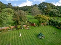 Luxury real estate A beautifully maintained country house on lovely grounds
