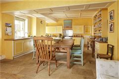 Mansions An elegant and beautifully located village house with a detached cottage
