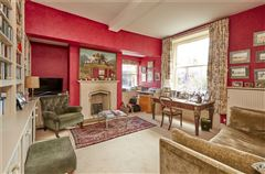 An elegant and beautifully located village house with a detached cottage mansions