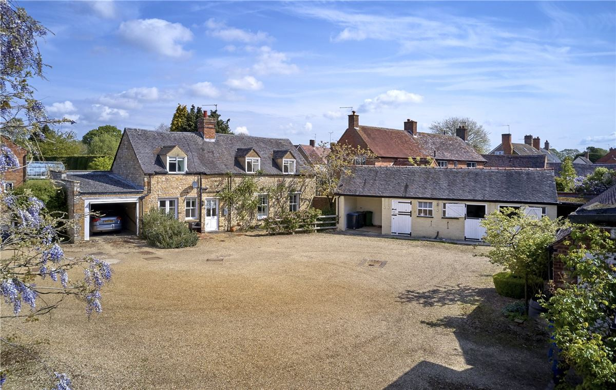 An elegant and beautifully located village house with a detached cottage luxury real estate