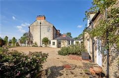 An elegant and beautifully located village house with a detached cottage luxury homes