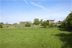 Luxury real estate An elegant and beautifully located village house with a detached cottage