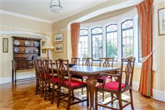 A substantial detached family home with attractive gardens  luxury real estate