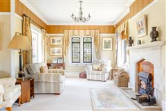 A substantial detached family home with attractive gardens  luxury properties