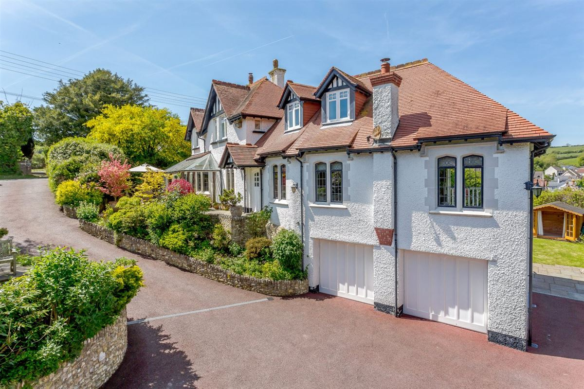 Luxury homes in A substantial detached family home with attractive gardens