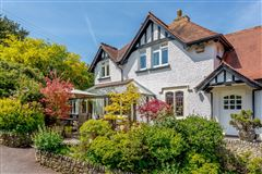 Luxury homes A substantial detached family home with attractive gardens
