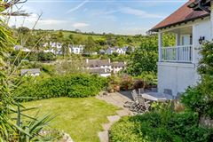 Luxury real estate A substantial detached family home with attractive gardens