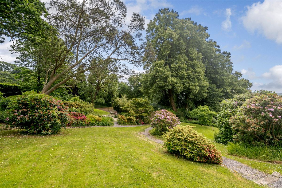 this elegant residence boasts beautiful gardens mansions