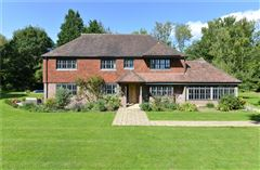 Luxury homes in handsome and substantial home on charming grounds
