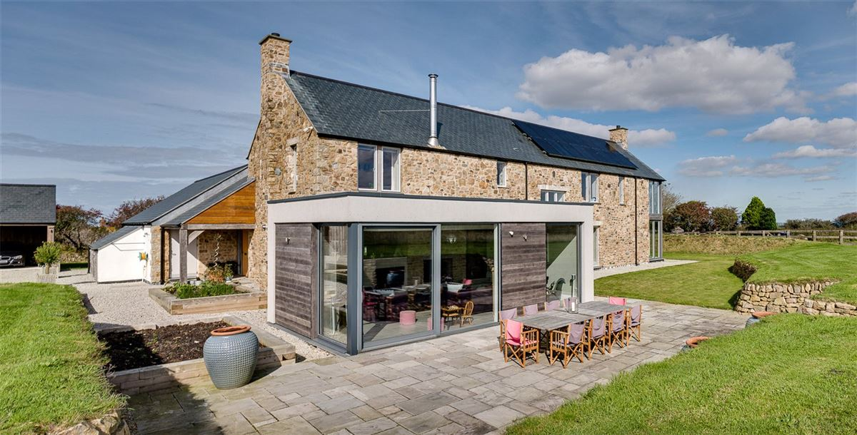 A contemporary farmhouse enjoying picturesque countryside views luxury properties
