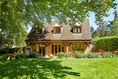 Luxury real estate stunning detached village house with lush gardens