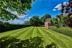 a charming wisteria-clad detached country house luxury real estate