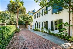 chic compound in historic south of broad luxury homes