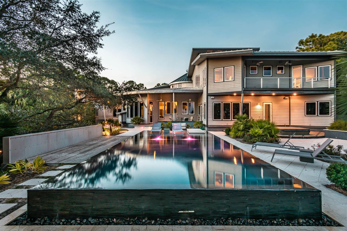 Luxury properties stunning modern home with unobstructed panoramic gulf views