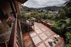 Mansions in tranquil oasis high above Kaneohe Bay