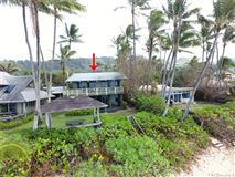 Luxury homes in beach front estate with views of hawaiian sunsets