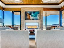 Architectural gem perched atop a peninsula lot luxury real estate