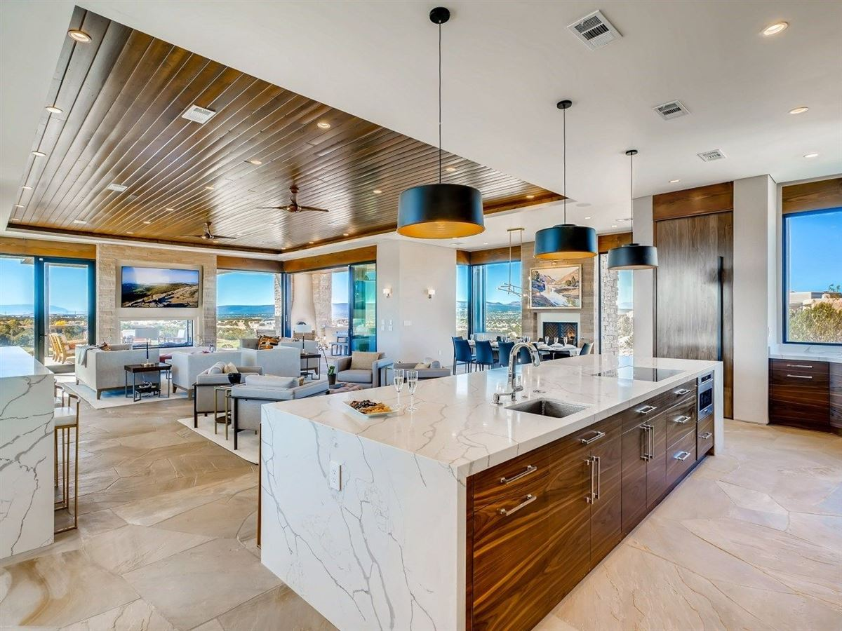 Architectural gem perched atop a peninsula lot luxury properties