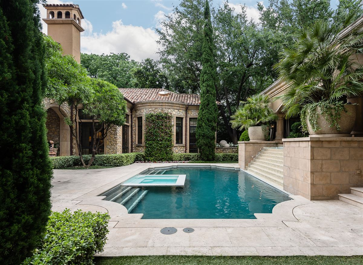 Luxury homes in exquisite home in exclusive gated Los Arboles Community