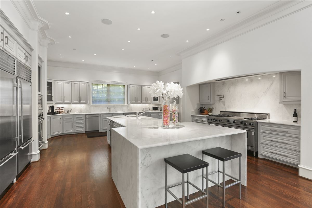 custom estate in coveted Bluffview luxury homes