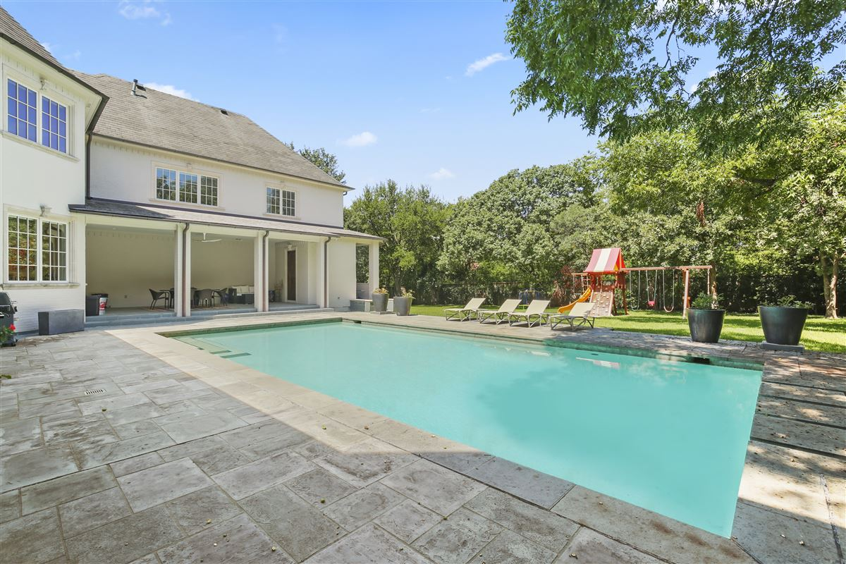 custom estate in coveted Bluffview luxury real estate