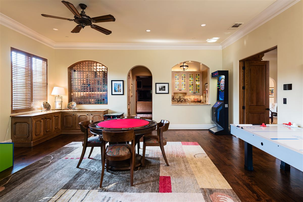 Mansions in gated and updated dallas retreat