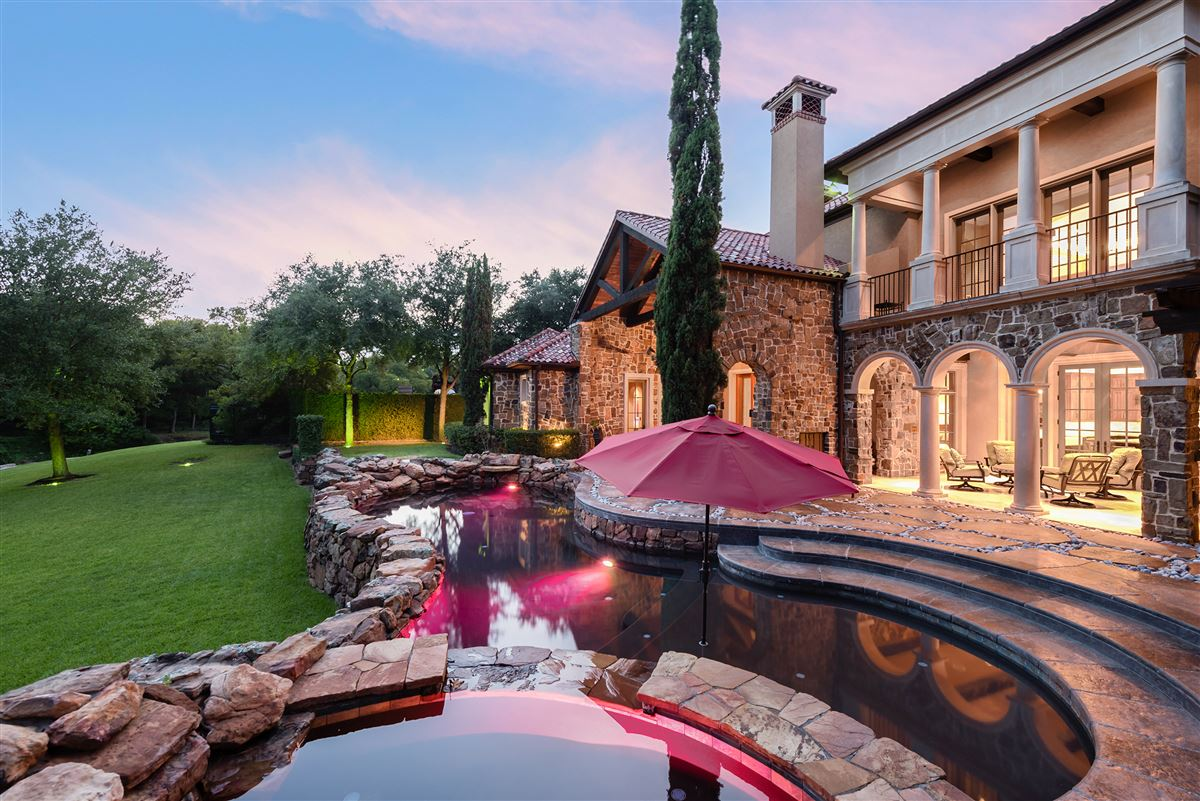 Luxury homes in gated and updated dallas retreat