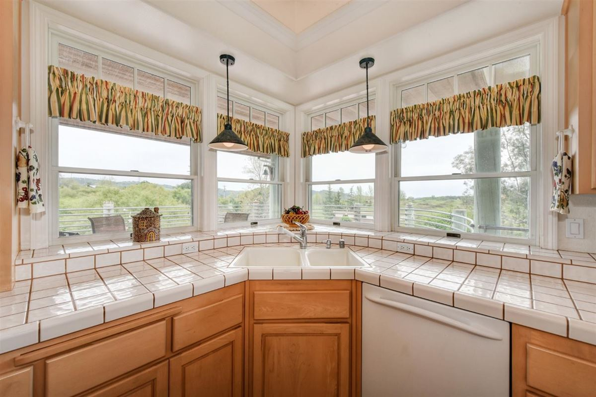 a Lovely knoll-top setting luxury real estate