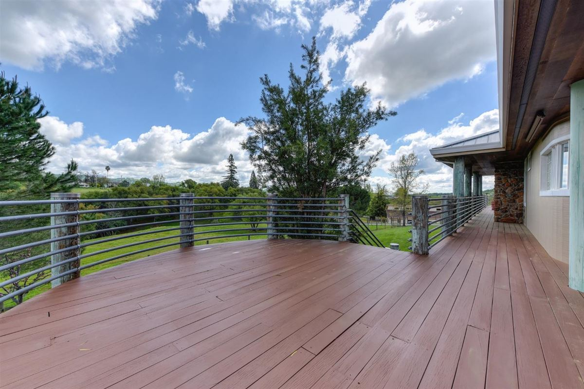 a Lovely knoll-top setting luxury homes