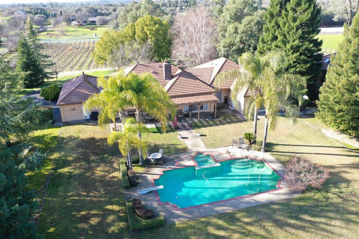 country property on five acres with vineyard mansions