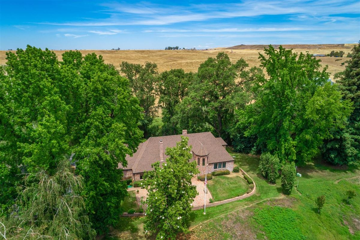 this stunning ranch property boasts a beautiful creek luxury real estate
