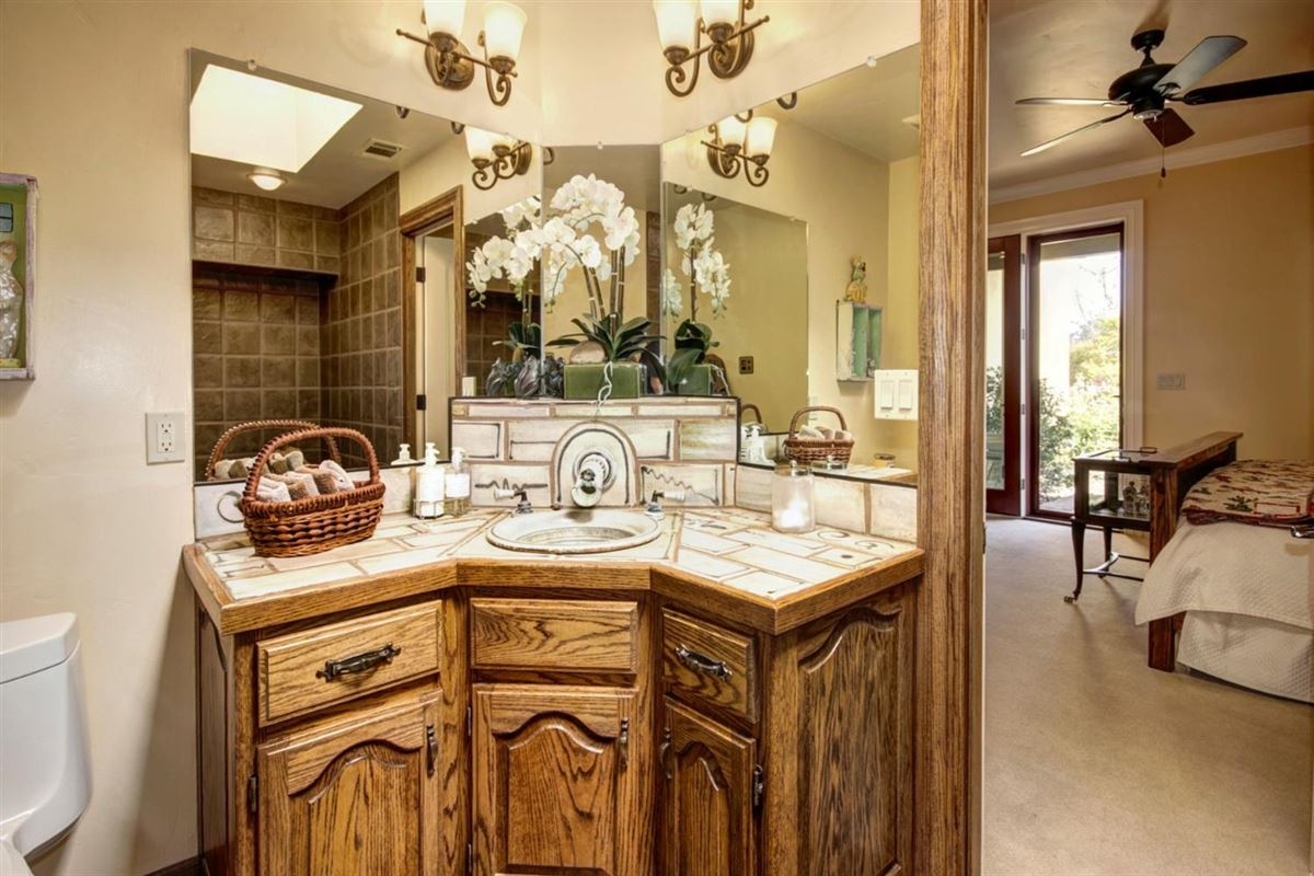 secluded mission style home on 13-plus acres luxury properties