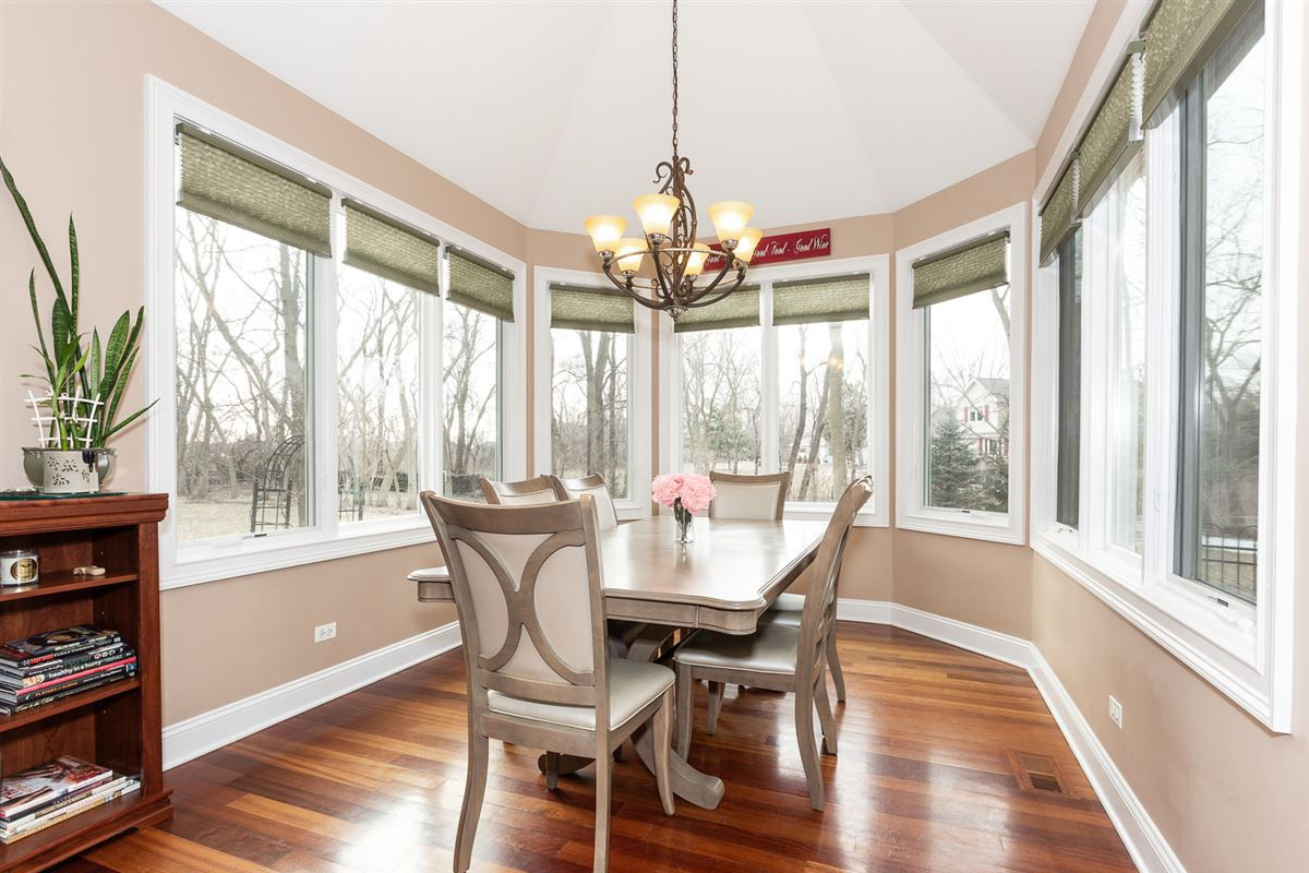 Luxury properties gorgeous home in Picturesque setting on wooded cul-de-sac lot