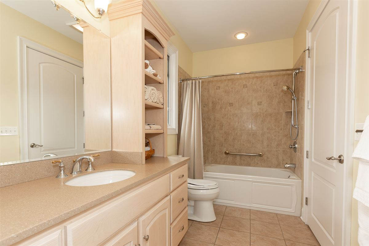 Luxury real estate gorgeous home in Picturesque setting on wooded cul-de-sac lot