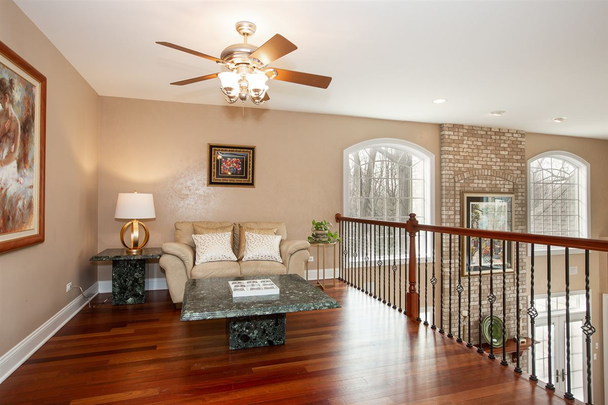 Mansions gorgeous home in Picturesque setting on wooded cul-de-sac lot