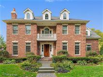 Beautiful newer brick Georgian on half acre lot luxury homes