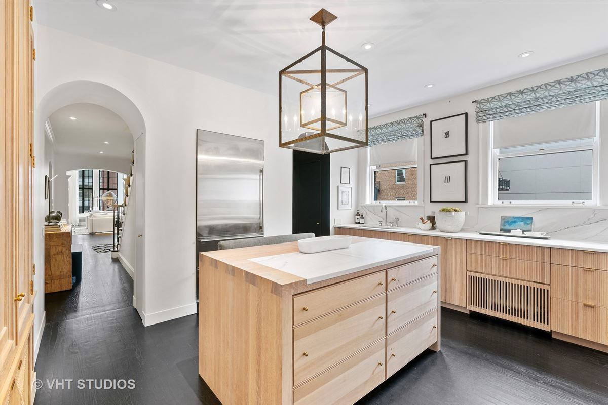 Luxury homes in this exquisitefully renovated duplex residence boasts award winning details