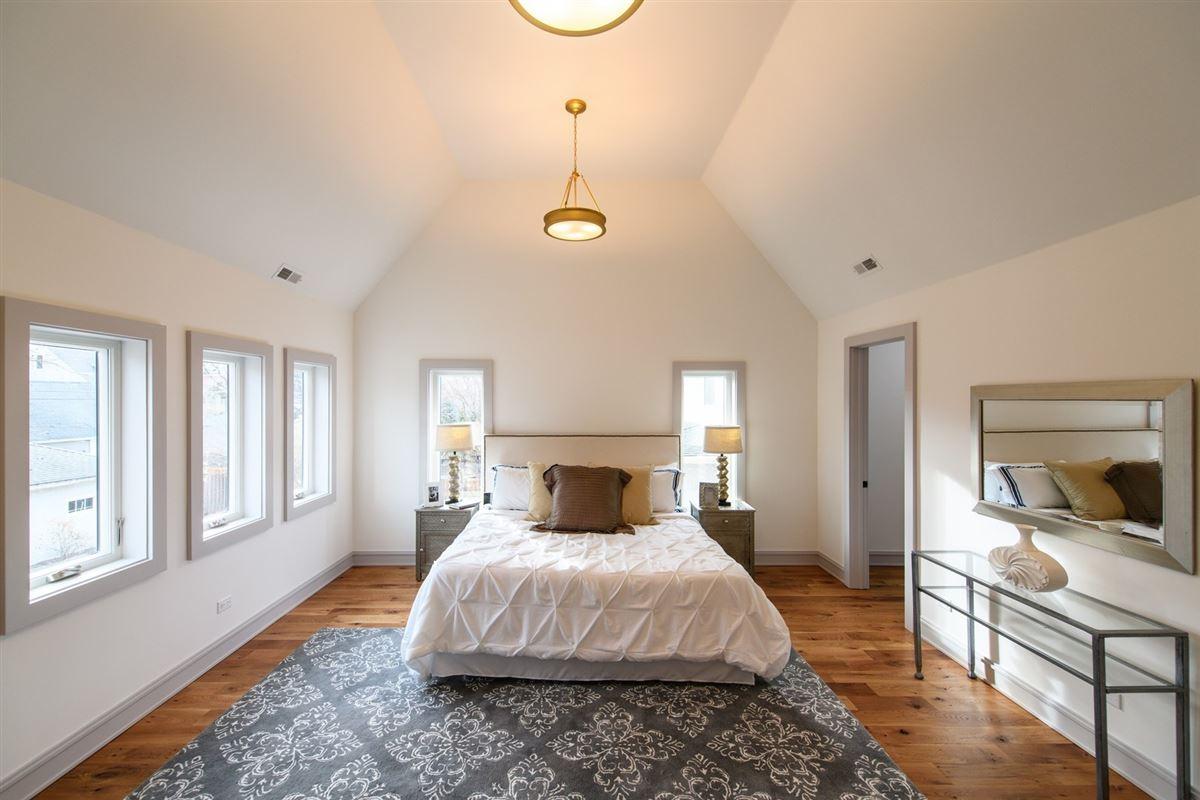 Luxury properties historic exterior with an urban farmhouse interior