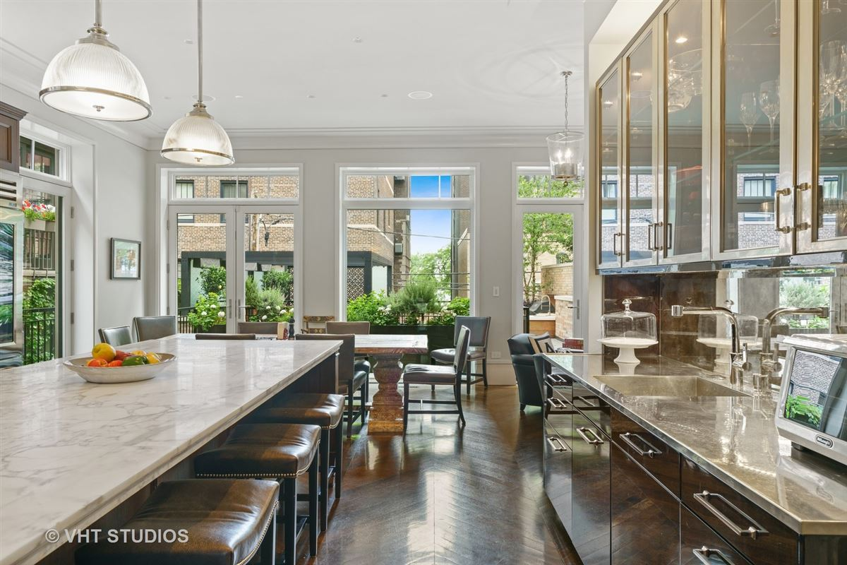 Mansions in Arguably the finest French Gothic home in the city on the most desirable block of Chicagos famed Gold Coast.