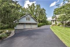 a meticulously maintained custom-built home luxury properties